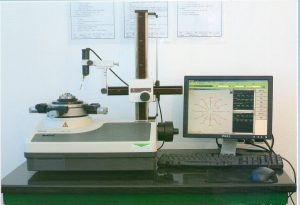 Roundness is tested on a special test stand that rotates the shaft when a sensor contacts the shaft allowing dimensional variations to be measured.
